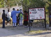 Residents of Zvimba, in rural Zimbabwe have their temperatures taken before seeking treatment at the local hospital on June, 25, 2021. (AP Photo/Tsvangirayi Mukwazhi)