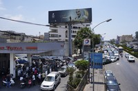 In this June 27, 2021 file photo, drivers wait in a long line to get fuel at a gas station in the southern suburbs of Beirut, Lebanon. (AP Photo/Hassan Ammar)