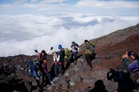Climbers pose for a commemorative photo on their way to the summit at the eighth station of the Yoshida trail on Mount Fuji in Yamanashi Prefecture, on June 30, 2021.  (Mainichi/Kota Yoshida)=Click/tap photo for more images.