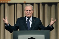 In this Oct. 11, 2011, file photo, former U.S. Secretary of Defense Donald Rumsfeld speaks to politicians and academics during a luncheon on security in rising Asia, in Taipei, Taiwan. (AP Photo/Wally Santana)