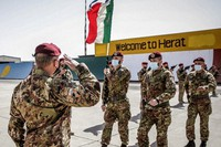 Italian Army soldiers carry the flag of the Folgore Brigade as the last Italian troops withdraw from Afghanistan, in Herat, on June 29, 2021. (Italian Defense Ministry via AP)