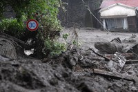 Debris including road signs is seen in the aftermath of a mudslide in Atami, Shizuoka Prefecture, on July 3, 2021. (Mainichi/Natsuki Nishi)