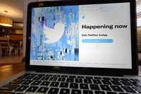 The login/sign up screen for a Twitter account is seen on a laptop computer on Tuesday, April 27, 2021, in Orlando, Fla. (AP Photo/John Raoux)