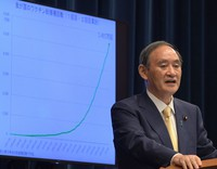 Prime Minister Yoshihide Suga speaks to reporters at his office in Tokyo on the evening of July 8, 2021, following the announcement of a fourth state of emergency for the capital over the coronavirus. (Mainichi/Kan Takeuchi)