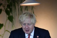 Britain's Prime Minister Boris Johnson visits the energy company Bulb in central London, on July 8, 2021. (Jeremy Selwyn/Pool via AP)