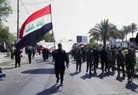 Iran-backed militia fighters march in central Baghdad, Iraq, on June 29, 2021. (AP Photo/Khalid Mohammed)