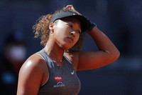 In this May 2, 2021, file photo, Naomi Osaka, of Japan, reacts during her match against Karolina Muchova, of the Czech Republic, at the Madrid Open tennis tournament in Madrid, Spain. (AP Photo/Paul White)