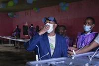 In this Monday, June 21, 2021 file photo, Ethiopia's Prime Minister Abiy Ahmed gestures to supporters after casting his vote in the general election, in his home town of Beshasha, in the Oromia region of Ethiopia. (AP Photo/Mulugeta Ayene, File)