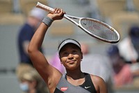 In this May 30, 2021, file photo, Japan's Naomi Osaka celebrates after defeating Romania's Patricia Maria Tig during a first-round match of the French Ppen tennis tournament at Roland Garros stadium in Paris. (AP Photo/Christophe Ena, File)