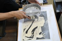 Mica mineral powder is sprinkled onto a reproduction of an ukiyo-e of