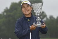 Nasa Hataoka, of Japan, holds the championship trophy after winning the Marathon Classic LPGA golf tournament at Highland Meadows Golf Club, on July 11, 2021, in Sylvania, Ohio. (AP Photo/David Dermer)