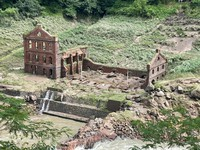 The walls of the remains of Sogi Power Station are seen collapsed in Isa, Kagoshima Prefecture, on July 11, 2021. (Photo courtesy of the Isa Municipal Government)