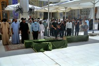 Mourners prepare to bury hospital fire victims in Najaf, Iraq, on July 13, 2021. (AP Photo/Anmar Khalil)
