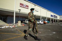 Soldiers patrol a shopping centre in Soweto, Johannesburg on July 13, 2021. (AP Photo/Themba Hadebe)