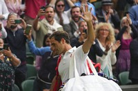 Switzerland's Roger Federer leaves the court after being defeated by Poland's Hubert Hurkacz during the men's singles quarterfinals match on day nine of the Wimbledon Tennis Championships in London, on July 7, 2021. (AP Photo/Alberto Pezzali)