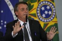 Brazil's President Jair Bolsonaro speaks during a ceremony at the Planalto presidential palace in Brasilia, Brazil, on July 13, 2021. (AP Photo/Eraldo Peres)