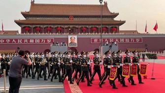 中国共産党創設100年を記念する祝賀大会の開始前、会場入りする音楽隊=北京市の天安門広場で2021年7月1日、小倉祥徳撮影