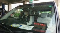 A taxi with a sign showing it is for people connected to the Tokyo Olympic Games is seen in Tokyo's Koto Ward on July 13, 2021. (Mainichi/Hajime Nakatsugawa)