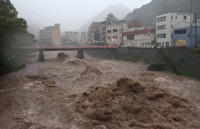 This Oct. 12, 2019 file photo shows a severely swollen river in Hakone, Kanagawa Prefecture, during Typhoon Hagibis. When the typhoon struck Japan, 922.5 millimeters of rain fell on the town of Hakone in a single day -- the most ever recorded in Japan. Research suggests that children born now may experience three torrential rain events beyond their grandparents' experience. (Mainichi/Haruo Sawa)