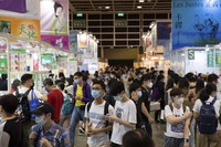 People visit the annual book fair in Hong Kong on July 14, 2021. (AP Photo/Matthew Cheng)