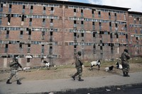 South African Defence Force soldiers on patrol alongside the male single sex hostels in Alexandra Township, north of Johannesburg, on July 15 2021. (AP Photo)