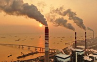 The sun sets near a coal-fired power plant on the Yangtze River in Nantong in eastern China's Jiangsu province on Dec. 12, 2018. (Chinatopix via AP)