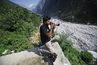 Reuters photographer Danish Siddiqui covers the monsoon floods and landslides in the upper reaches of Govindghat, India, on June 22, 2013. (AP Photo/Rafiq Maqbool)