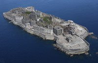 "This file photo taken Sept. 29, 2020, from a Mainichi Shimbun helicopter shows the Hashima Coal Mine on Hashima Island, popularly known as ""Battleship Island,"" off Nagasaki in southwestern Japan. (Mainichi)"