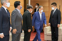 Prime Minister Yoshihide Suga, second from right, is seen during a Cabinet meeting at his office on July 16, 2021. (Mainichi/Kan Takeuchi)