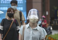 People wear face masks to help protect against the spread of the coronavirus after the COVID-19 alert rose to level 3 in Taipei, Taiwan, on July 12, 2021. (AP Photo/Chiang Ying-ying)