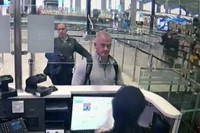 This Dec. 30, 2019 image from security camera video shows Michael L. Taylor, center, and George-Antoine Zayek at passport control at Istanbul Airport in Turkey. (DHA via AP)
