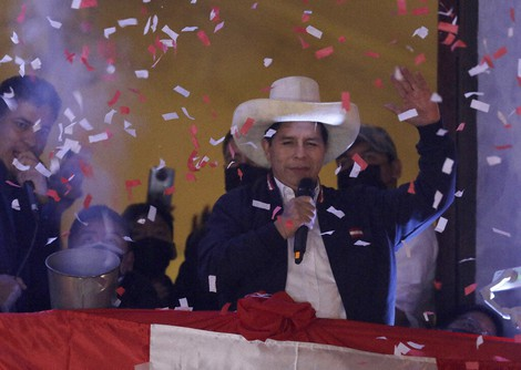 Pedro Castillo waves to supporters after election authorities declared him president-elect during celebrations at his party's campaign headquarters in Lima, Peru, on July 19, 2021. (AP Photo/Guadalupe Prado)