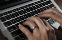 In this June 19, 2017 file photo, a person types on a laptop keyboard in North Andover, Massachusetts. (AP Photo/Elise Amendola)