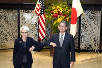 U.S. Deputy Secretary of State Wendy Sherman, left, elbow bumps with Japanese Vice-Minister for Foreign Affairs Takeo Mori, right, prior to their meeting at the Iikura Guesthouse on July 20, 2021, in Tokyo. (AP Photo/Eugene Hoshiko, Pool)