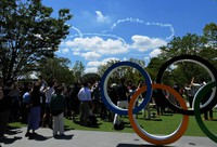 Olympic rings drawn in the sky by Japan's Air Self-Defense Force aerobatics team Blue Impulse are seen from Tokyo's Shibuya Ward on July 21, 2021, in a rehearsal two days before the games' opening. (Mainichi/Koichiro Tezuka)