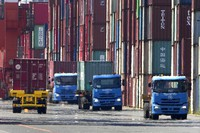 Heat waves distort trucks and shipping containers as work continues at a dock along Tokyo Bay ahead of the 2020 Summer Olympics, on July 19, 2021, in Tokyo. (AP Photo/Charlie Riedel)