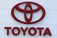 This Aug. 15, 2019, file photo shows the Toyota logo on a dealership in Manchester, N.H. (AP Photo/Charles Krupa)