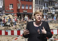 German Chancellor Angela Merkel speaks at a press conference in Muenstereifel, Germany, on July 20, 2021. (Oliver Berg/dpa via AP, Pool)