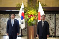 South Korean First Vice Foreign Minister Choi Jong Kun, left, and Japanese Foreign Vice-Minister Takeo Mori pose for photographs prior to their bilateral meeting at the Iikura Guesthouse in Tokyo on July 20, 2021. (Franck Robichon/Pool Photo via AP)