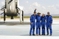 Oliver Daemen, from left, Jeff Bezos, founder of Amazon and space tourism company Blue Origin, Wally Funk and Bezos' brother Mark pose for photos in front of the Blue Origin New Shepard rocket, left rear, after their launch from the spaceport near Van Horn, Texas, on July 20, 2021. (AP Photo/Tony Gutierrez)