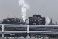 In this Oct. 21, 2013 file photo, smoke billows from an oil refinery in Kawasaki, southwest of Tokyo. (AP Photo/Koji Sasahara)