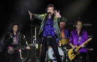 In this Aug. 22, 2019 file photo, Mick Jagger, center, performs with his Rolling Stones bandmates, from left, Ron Wood, Charlie Watts and Keith Richards during their concert at the Rose Bowl in Pasadena, Calif. (Photo by Chris Pizzello/Invision/AP)
