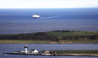 In this Jan. 1, 2021 file photo, a P&O ferry from Scotland crosses the Irish Sea making way towards the port at Larne on the north coast of Northern Ireland. (AP Photo/Peter Morrison)