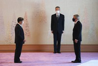 International Olympic Committee President Thomas Bach, right, is greeted by Emperor Naruhito at the Imperial Palace in Tokyo on July 22, 2021. (Pool)