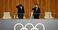 Emperor Naruhito is seen waving from the royal box, as International Olympic Committee President Thomas Bach stands at left, at the Japan National Stadium in the capital's Shinjuku Ward on July 23, 2021. (Mainichi/Noriko Tokuno)