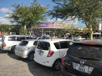 Secondhand Japanese cars are seen lined up at a parking lot in a shopping mall in Zambia's capital Lusaka on June 1, 2021. (Mainichi/Mitsuyoshi Hirano)