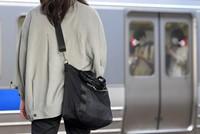 A Railway Police Unit investigator is seen on a station platform in Fukuoka's Hakata Ward on May 27, 2021. Female investigators respond to cases involving female victims. (Mainichi/Toyokazu Tsumura)
