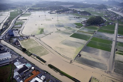 The Tenjo River in Hiroshima Prefecture is seen flooding surrounding areas following torrential rains, in this photo taken from a Mainichi Shimbun helicopter on July 8, 2021. (Mainichi)
