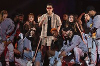 Singer Kris Wu, center, performs in the 2017 Tmall 11.11 Global Shopping Festival gala, in Shanghai, China, on Nov. 10, 2017. (Chinatopix via AP)