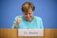 German Chancellor Angela Merkel gestures as she holds her annual summer news conference in Berlin, Germany, on July 22, 2021. (Hannibal Hanschke/Pool Photo via AP)